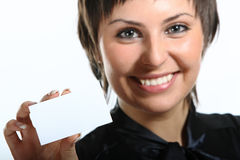 young woman holding a white card. Stock Photos