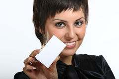 Young woman holding a white card. Royalty Free Stock Photo