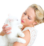 Young woman holding white cat. Royalty Free Stock Image