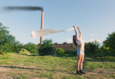 Young woman holding a white clean cloth in the wind. Girl holding a white clean cloth in the wind Royalty Free Stock Photo
