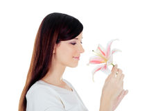 Young woman holding a white lily at face isolated over Stock Image