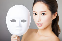 Young woman holding white mask Royalty Free Stock Images