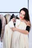 Young woman holding white mink fur coat Stock Image