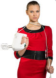 Young woman holding white mixer and pull cord Stock Photo