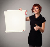 Young woman holding white origami paper copy space Stock Photos
