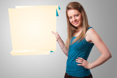 Young woman holding white origami paper copy space Royalty Free Stock Photography
