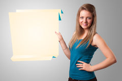 Young woman holding white origami paper copy space Royalty Free Stock Photo