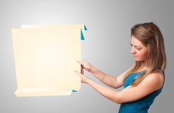 Young woman holding white origami paper copy space Stock Photo