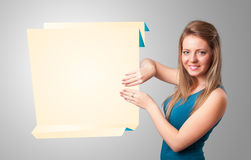 Young woman holding white origami paper copy space Stock Photography