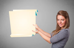 Young woman holding white origami paper copy space Royalty Free Stock Images