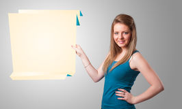Young woman holding white origami paper copy space Royalty Free Stock Photos