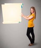 Young woman holding white origami paper copy space stock image