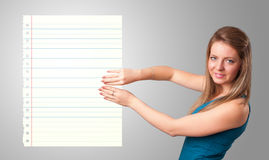 Young woman holding white paper copy space with diagonal lines Stock Photo