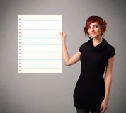 Young woman holding white paper copy space with diagonal lines Royalty Free Stock Photos