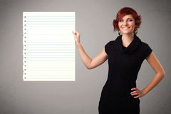 Young woman holding white paper copy space with diagonal lines Stock Images
