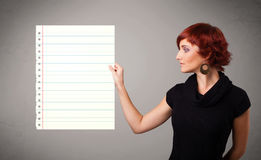 Young woman holding white paper copy space with diagonal lines Royalty Free Stock Photo