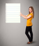 Young woman holding white paper copy space with diagonal lines Stock Photography