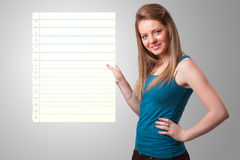 Young woman holding white paper copy space with diagonal lines Stock Image