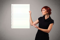 Young woman holding white paper copy space with diagonal lines Royalty Free Stock Images