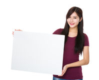 Young woman holding with white poster Stock Photography