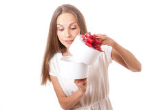 Young woman holding white round gift box Stock Photo