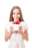 Young woman holding white round gift box Stock Images