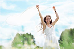 Young woman holding white scarf to wind Royalty Free Stock Images
