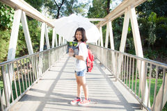 Young woman holding a white umbrella. Stock Image