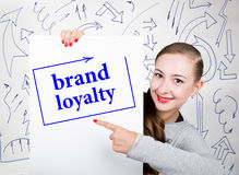 Young woman holding whiteboard with writing word: brand loyalty. Technology, internet, business and marketing. Young woman holding whiteboard with writing word stock images