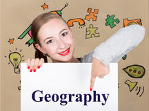 Young woman holding whiteboard with writing word: geography. Technology, internet, business and marketing. Stock Photo