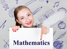 Young woman holding whiteboard with writing word: mathematics. Technology, internet, business and marketing. Royalty Free Stock Photos