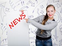 Young woman holding whiteboard with writing word: news. Technology, internet, business and marketing. Royalty Free Stock Images