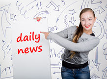 Young woman holding whiteboard with writing word: daily news. Technology, internet, business and marketing. Royalty Free Stock Image