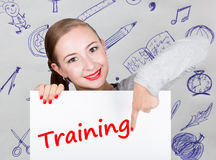 Young woman holding whiteboard with writing word: training. Technology, internet, business and marketing. Royalty Free Stock Photos