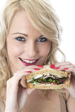 Young Woman Holding Wholemeal Sandwich Ready to Eat Stock Image