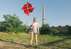 Young woman holding a windmill royalty free stock image