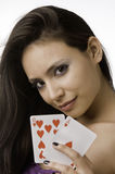 Young woman holding wining card and Royalty Free Stock Photography