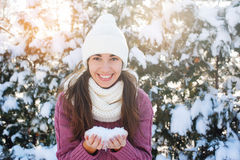 Young woman holding a winter snow Royalty Free Stock Image
