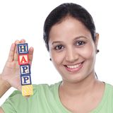 Young woman holding wooden blocks of word. Happy with her hand Stock Photography