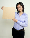 Young woman holding a wooden square Royalty Free Stock Image