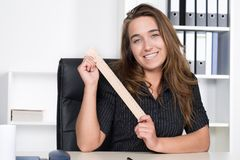 Young woman is holding a wooden ruler Stock Photos