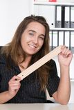 Young woman is holding a wooden ruler Royalty Free Stock Images