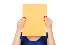 Young woman holding yellow blank sign card Stock Photo