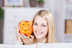 Young Woman Holding Yellow Piggybank Stock Photos