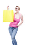 Young woman holding a yellow shopping bag Stock Photography