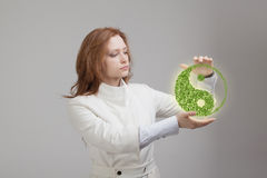 Young woman holding ying yang symbol Royalty Free Stock Images