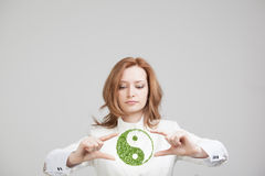 Young woman holding ying yang symbol Stock Images