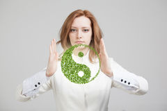 Young woman holding ying yang symbol Stock Image