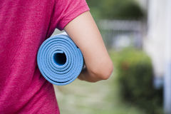 Young woman holding a yoga mat. In the outdoor Royalty Free Stock Images