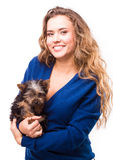 Young woman holding Yorkshire terrier dog Stock Photo